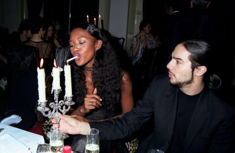 <p>When Naomi had a flamenco dancer use a candelabra to light her cig. </p>
