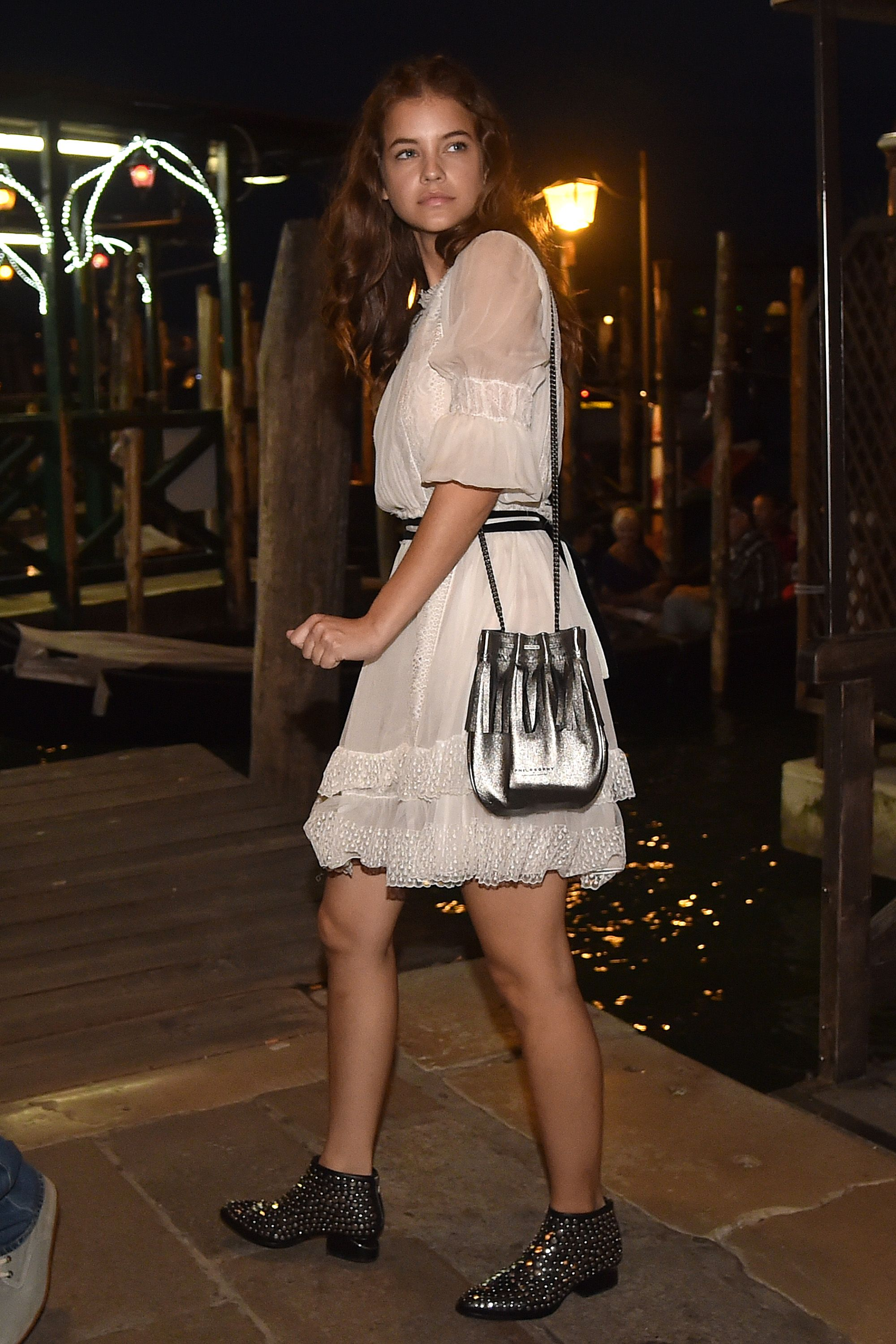 <p>Yours doesn't have to be Alberta Ferretti, but a ruffly, puff-sleeve dress always looks good against something hard. (The studded boots, in this case.)</p>