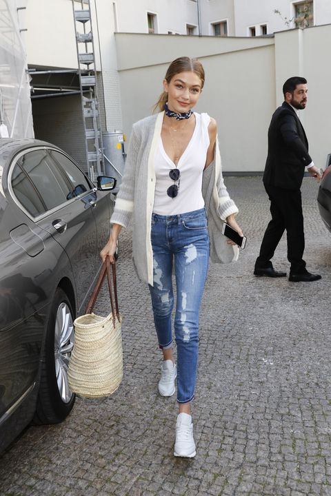 <p>Will a T-shirt and jeans never *not* be an ideal outfit? Here, she's added a cardigan and neckerchief—and a straw bag, because ~summer vibes~ are infinite. (And straw bags are still very, very hot at the moment.)&nbsp;</p>