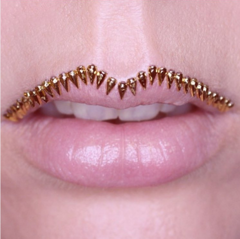 Lip, Brown, Skin, Pink, Jewellery, Amber, Organ, Natural material, Fashion accessory, Beauty,