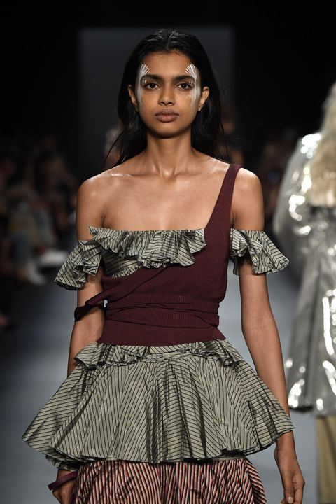 <p>At Tome, the formula was reversed, with the OTS top worn underneath a body-con tank for a corset effect.&nbsp;&nbsp;</p>