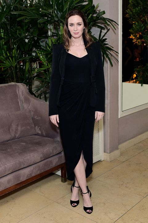 <p>In a black velvet dress and Chopard jewelry</p>
