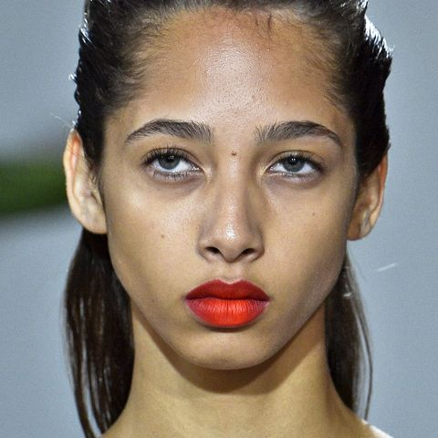 """<p>Give your red lip an unexpected pop of color (and contour your&nbsp;pout in the process) by dabbing neon orange onto the center of the lips and blurring it out as seen at Jason Wu Spring 2017. Yes, it's statement-making, but also wearable as you can dial the tangerine accent up or down as desired and applying it with your fingers gives&nbsp;it a more lived-in feel.&nbsp;<span class=""""redactor-invisible-space"""" data-verified=""""redactor"""" data-redactor-tag=""""span"""" data-redactor-class=""""redactor-invisible-space""""></span></p>"""