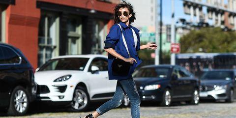 Clothing, Eyewear, Tire, Vision care, Road, Land vehicle, Trousers, Shirt, Car, Street,