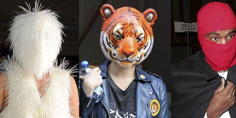 Bengal tiger, Costume accessory, Jacket, Tiger, Fur, Big cats, Siberian tiger, Felidae, Leather jacket, Snout,