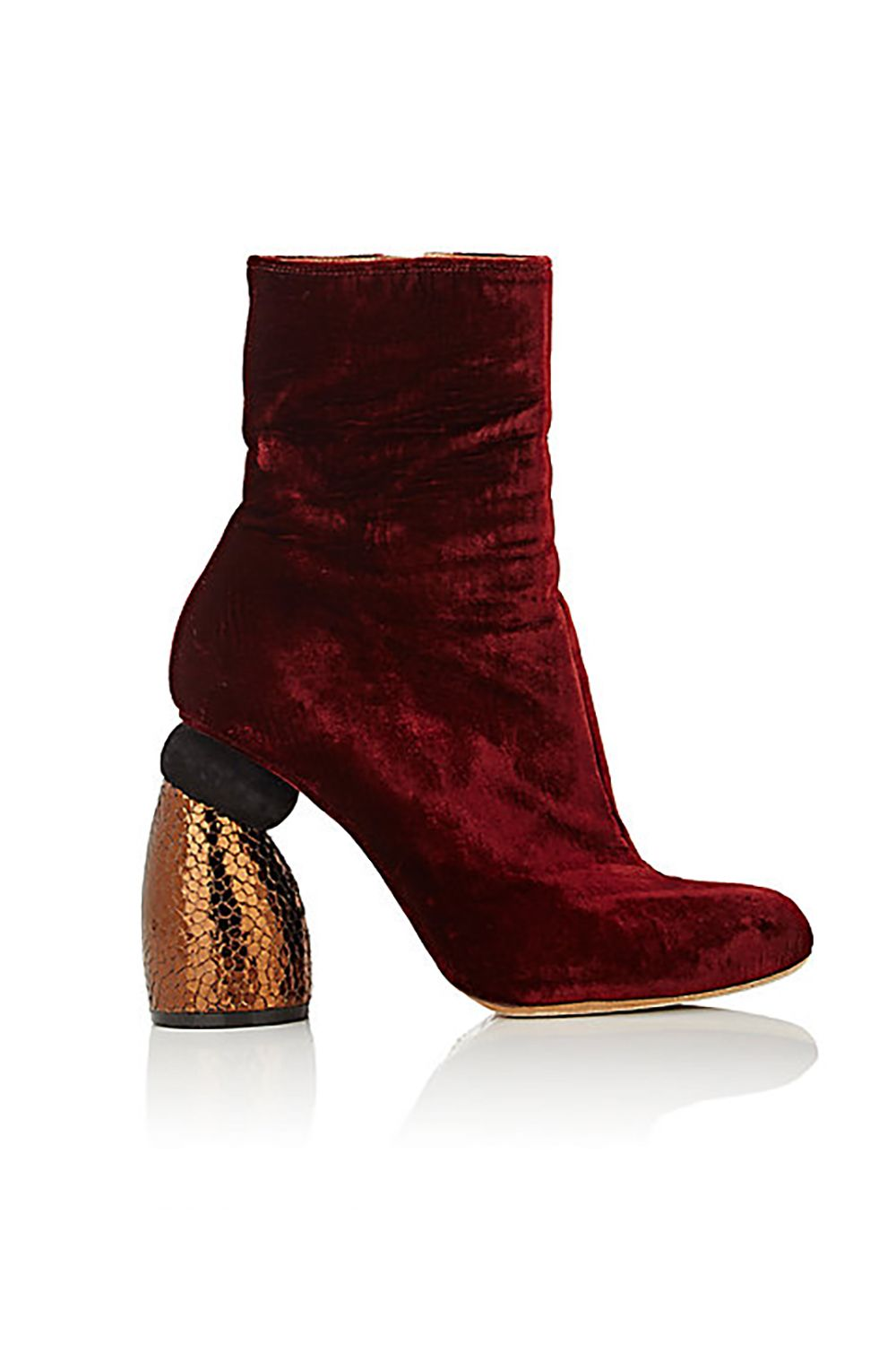"""<p>Burgundy velvet on a curvycopper leather heel is <i data-redactor-tag=""""i"""">totally</i> worth the splurge.</p><p>$980,<a href=""""http://www.barneys.com/product/dries-van-noten-sculpted-heel-ankle-boots-504682452.html"""" target=""""_blank"""">barneys.com</a></p>"""
