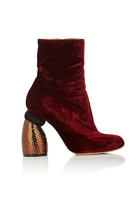 "<p>Burgundy velvet on a curvy&nbsp;copper leather heel is <i data-redactor-tag=""i"">totally</i> worth the splurge.</p><p>$980,&nbsp;<a href=""http://www.barneys.com/product/dries-van-noten-sculpted-heel-ankle-boots-504682452.html"" target=""_blank"">barneys.com</a>&nbsp;</p>"