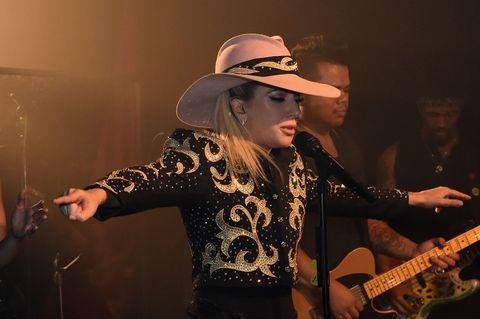 Arm, Hat, Human body, Guitarist, Music, Musician, Musical instrument accessory, Hand, Performing arts, Music artist,
