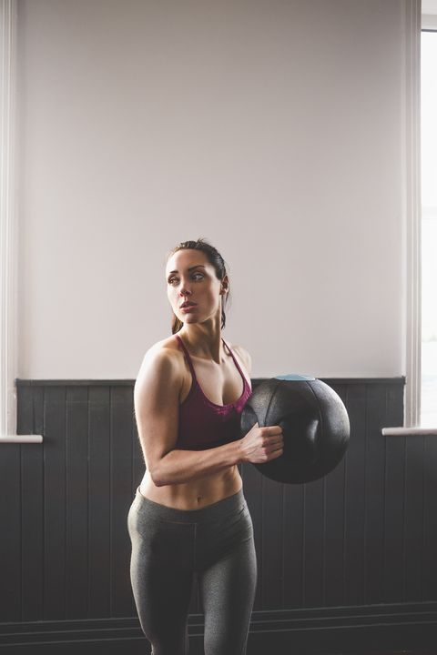 """<p><strong data-redactor-tag=""""strong"""" data-verified=""""redactor""""></strong><strong data-redactor-tag=""""strong"""" data-verified=""""redactor"""">Equipment Needed:</strong> Weight plate or ball</p><p><br></p><p><strong data-redactor-tag=""""strong"""" data-verified=""""redactor"""">Directions: </strong>Stand up straight with your feet placed a little more than shoulder width apart and with a 10-15 pound weight plate in your hands, square in front of your torso. With your pelvis tucked&nbsp;under, twist your torso to the right bringing your right knee up toward the weight. Contract your abdominals and twist your torso back to center, returning your foot to the floor. Complete 15 """"standing twist crunches"""" per side, then change sides for a total&nbsp;of 3 sets. Finish all reps on one side before beginning reps on the other.&nbsp;</p>"""