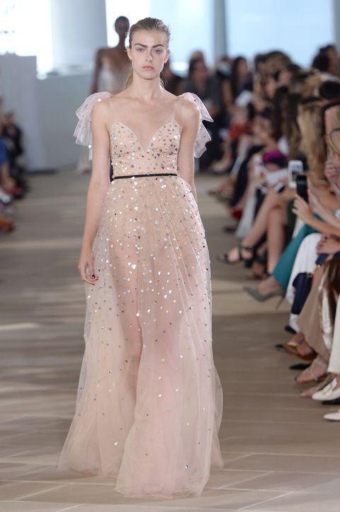 "<p>I love all these ethereal, hippie-princess dresses that are all over the place, like at Monique Lhuillier. They're just a teeny bit sexy because they're see-through, but so unbelievably elegant as well.<span class=""redactor-invisible-space"" data-verified=""redactor"" data-redactor-tag=""span"" data-redactor-class=""redactor-invisible-space""></span></p>"