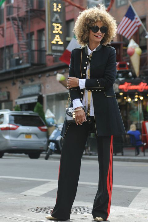 "<p>Bounce straight from the boardroom to the bar in a trumped-up two-piece suit. Striped trousers and a military-inspired jacket mean business, while metallic touches and a stack of bangles add festive bling. ""I love mixing metals; silver accessories are the perfect accent without being OTT,"" De Silva says. </p>  <p><em data-redactor-tag=""em"" data-verified=""redactor"">Mango Jacket; Zara Shirt and Pants; Furla Bag; Steve Madden Shoes; PANDORA Jewelry Bangles, price varies, </em><a href=""http://estore-us.pandora.net/en-us/bracelets/bangle/?cid=BrndMedia_Drop6_Dec_2016_MarieClaire_CustomContent_NativeInfluenceArticles_Bangles_Collection"" target=""_blank"" data-tracking-id=""recirc-text-link""><em data-redactor-tag=""em"" data-verified=""redactor"">pandora.net</em></a></p>"