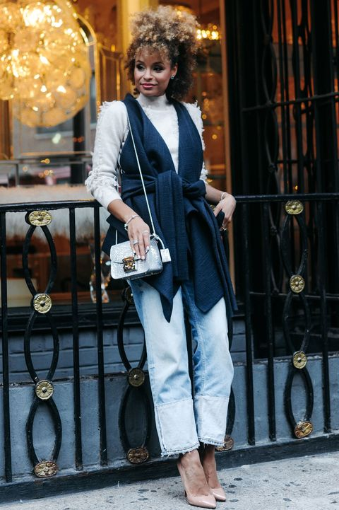 "<p>Distressed denim gets a serious upgrade with nude pumps, a fringy sweater, and a vest with an exaggerated belt to tie it together. Don't forget the matching metallic bag and accessories to spruce up the laid-back look: ""Silver really pops against blue,"" says De Silva. </p>  <p><em data-redactor-tag=""em"" data-verified=""redactor"">One Grey Day Sweater;  Rad Hourani Vest;  Zara Jeans; Christian Louboutin Shoes; Furla Bag; PANDORA Jewelry Crystalized Blues, price varies, </em><a href=""http://estore-us.pandora.net/en-us/holiday-color%3A-blue/?icid=WinterHues_Row2C1_Blue/&amp;cid=BrndMedia_Drop6_Dec_2016_MarieClaire_CustomContent_NativeInfluenceArticles_HolidayColorBlue_Assortment"" target=""_blank"" data-tracking-id=""recirc-text-link""><em data-redactor-tag=""em"" data-verified=""redactor"">pandora.net</em></a></p>"