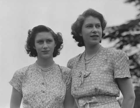 Queen Elizabeth II and Princess Margaret wearing summer dresses, circa 1942.  (Photo by Studio Lisa/Getty Images)