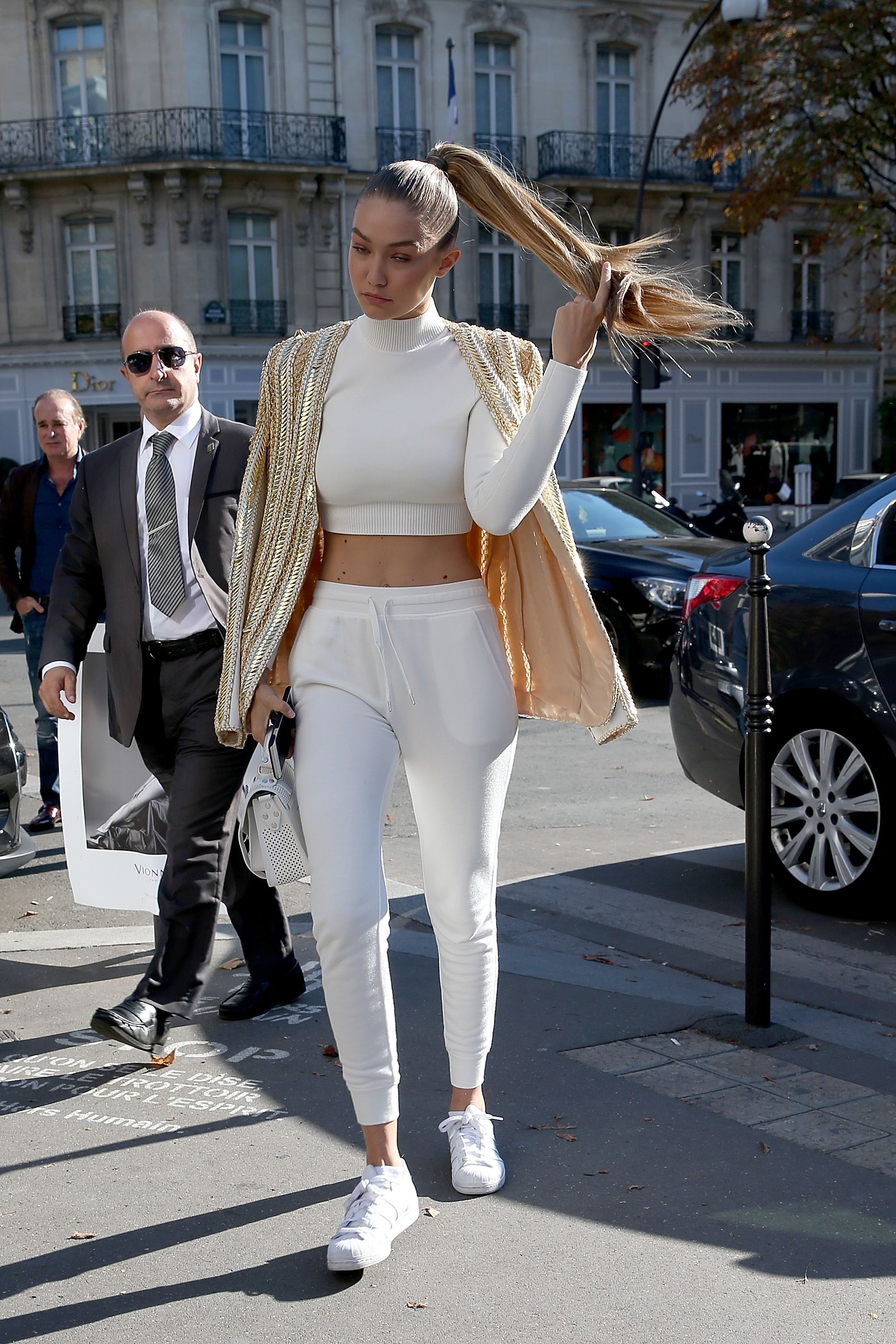 "<p>Continued: <em data-redactor-tag=""em"" data-verified=""redactor"">The Audacity of Fleece in Paris</em>, which is what Gigi Hadid should title her memoirs. Here, as an athleisure angel in all white, she sends a message of comfort and joy and taking pride in the quintessentially American trait of DGAF-ness. </p>"