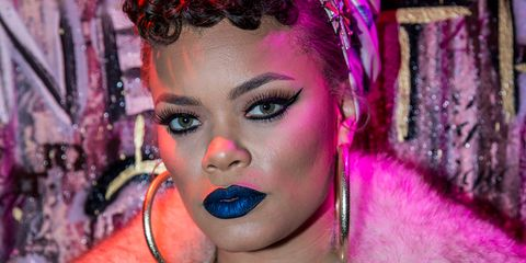 <p>Always one for a bold lip, the songstress donned a midnight&nbsp;blue shade with a metallic finish for a gig.</p>