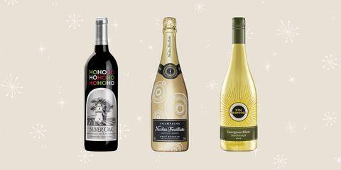 Glass bottle, Product, Yellow, Bottle, Alcohol, Drink, Alcoholic beverage, Bottle cap, Liquid, Logo,