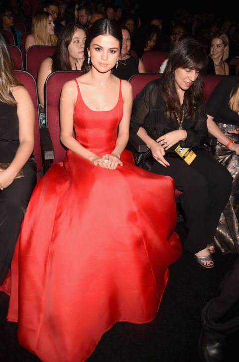 Dress, Trousers, Event, Shoulder, Red, Formal wear, Style, Strapless dress, Gown, Fashion model,
