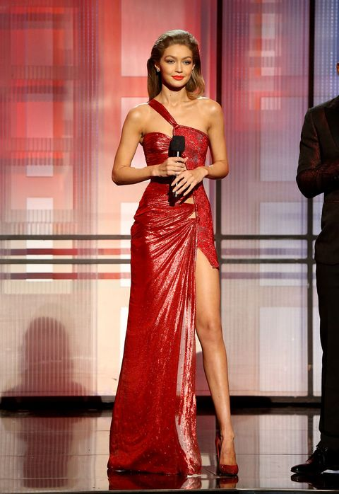 Shoulder, Dress, Red, Formal wear, Fashion model, Fashion accessory, Fashion, Gown, Waist, Model,