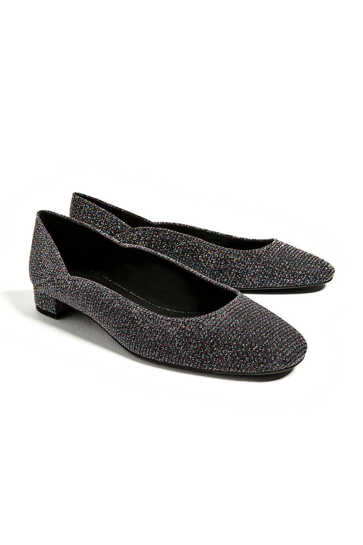 "<p>The Lurex turtleneck of glove shoes.</p><p>$30, <a href=""http://www.zara.com/us/en/woman/shoes/flats/shiny-ballerinas-c269196p4205503.html"" target=""_blank"" data-tracking-id=""recirc-text-link"">zara.com</a>.</p>"