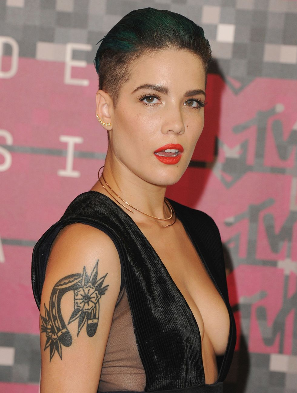 "Halsey Singer Halsey broke down the meanings of all of her many ink etchings to iHeart Radio , where she explained that she chose the upside down horseshoe on her right arm despite the fact that's it's supposedly bad luck. ""I got an upside down horseshoe to signify that I don't need luck. I work really, really hard, and I believe in the stars aligning, but I don't believe that anything happens to anyone based out of sheer luck. I believe people work really hard, and they manifest what they want, and what they need, and what they're hopeful for, and that's what this is—a reminder."""