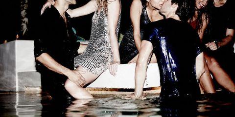 Leg, Fun, Social group, Dress, Interaction, Fashion, Thigh, Barefoot, One-piece garment, Foot,