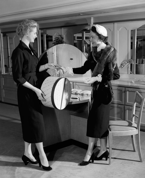 Style, Hat, Monochrome photography, Monochrome, Black-and-white, Chair, Suit trousers, Kitchen & dining room table, Vintage clothing, Sun hat,