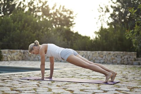 <p>The plank pose is a trifecta: a core and back strengthener plus a heart opener. The legs and glutes are fired up, and the belly pulls up to support the back of the body while the sternum bone slides forward. The shoulder blades are in their pockets, giving the collarbones space to smile wide. Keep the neck long as a natural extension of the spine and most importantly...breathe. </p>