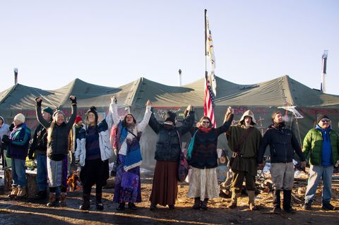 People, Social group, Community, Pole, Flag, Tent, Crew,