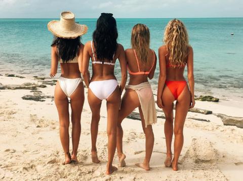 Clothing, Leg, Fun, Swimsuit top, Bikini, Hat, Brassiere, Sand, Beach, Coastal and oceanic landforms,