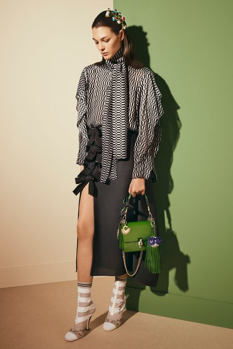 Brown, Sleeve, Joint, Human leg, Bag, Fashion accessory, Style, Knee, Waist, Pattern,