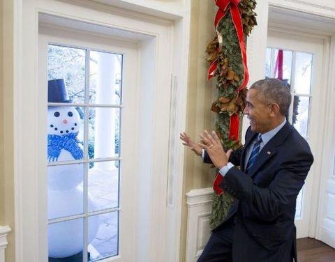 Snowman, Coat, Interior design, Suit, Fixture, Interior design, Blazer, Tie, Ornament, Christmas decoration,
