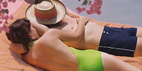 Skin, Shoulder, Hat, Joint, Elbow, Wrist, Human leg, Sun hat, Back, Costume accessory,