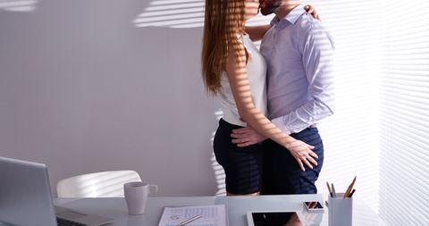 Interior design, Interaction, Interior design, Romance, Drinkware, Gesture, Love, Cup, Waist, Office equipment,