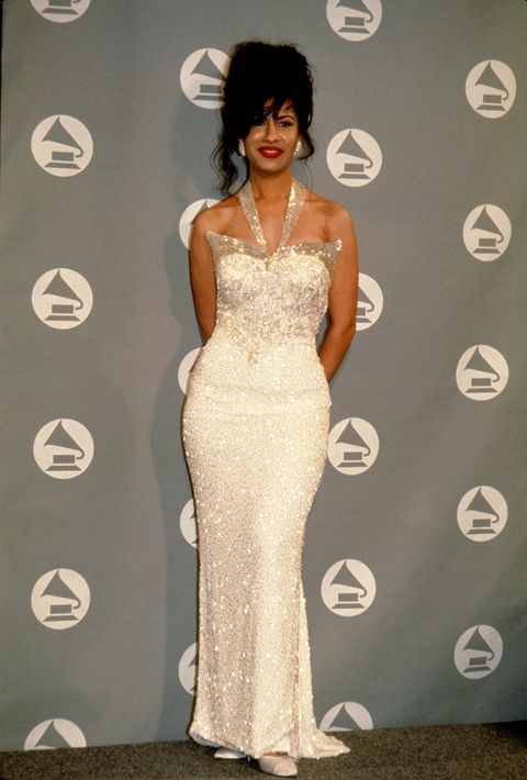 "<p>The picture of red-carpet glamour, Selena arrived at the Grammy's wearing a sparkly white halter dress, a bouffant, and her signature red lip. </p>""/></figure>    <p>The late Selena wore this iconic dress to the Grammy's in 1994. She is wearinga  sparkly white halter dress with a red lip.</p>    <p>Picture credit: Getty Images</p>    <p></p>    <h2>5. Mary J. <g class="