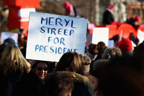 "AMSTERDAM, NETHERLANDS - JANUARY 21:  Demonstrators with a sign saying "" Meryl Streep for President "" make their way from the iamsterdam statue in front of the Rijksmuseum towards US Consulate during the Women's March held at Museumplein on January 21, 2017 in Amsterdam, Netherlands.  The Women's March originated in Washington DC but soon spread to be a global march calling on all concerned citizens to stand up for equality, diversity and inclusion and for women's rights to be recognised around the world as human rights. Global marches are now being held, on the same day, across seven continents.  (Photo by Dean Mouhtaropoulos/Getty Images)"