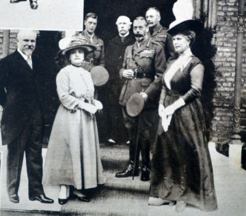 "<p>King George V, Queen Mary, and the Prince of Wales are seen out in front of the British Officers' club. <span class=""redactor-invisible-space"" data-verified=""redactor"" data-redactor-tag=""span"" data-redactor-class=""redactor-invisible-space""></span></p>"