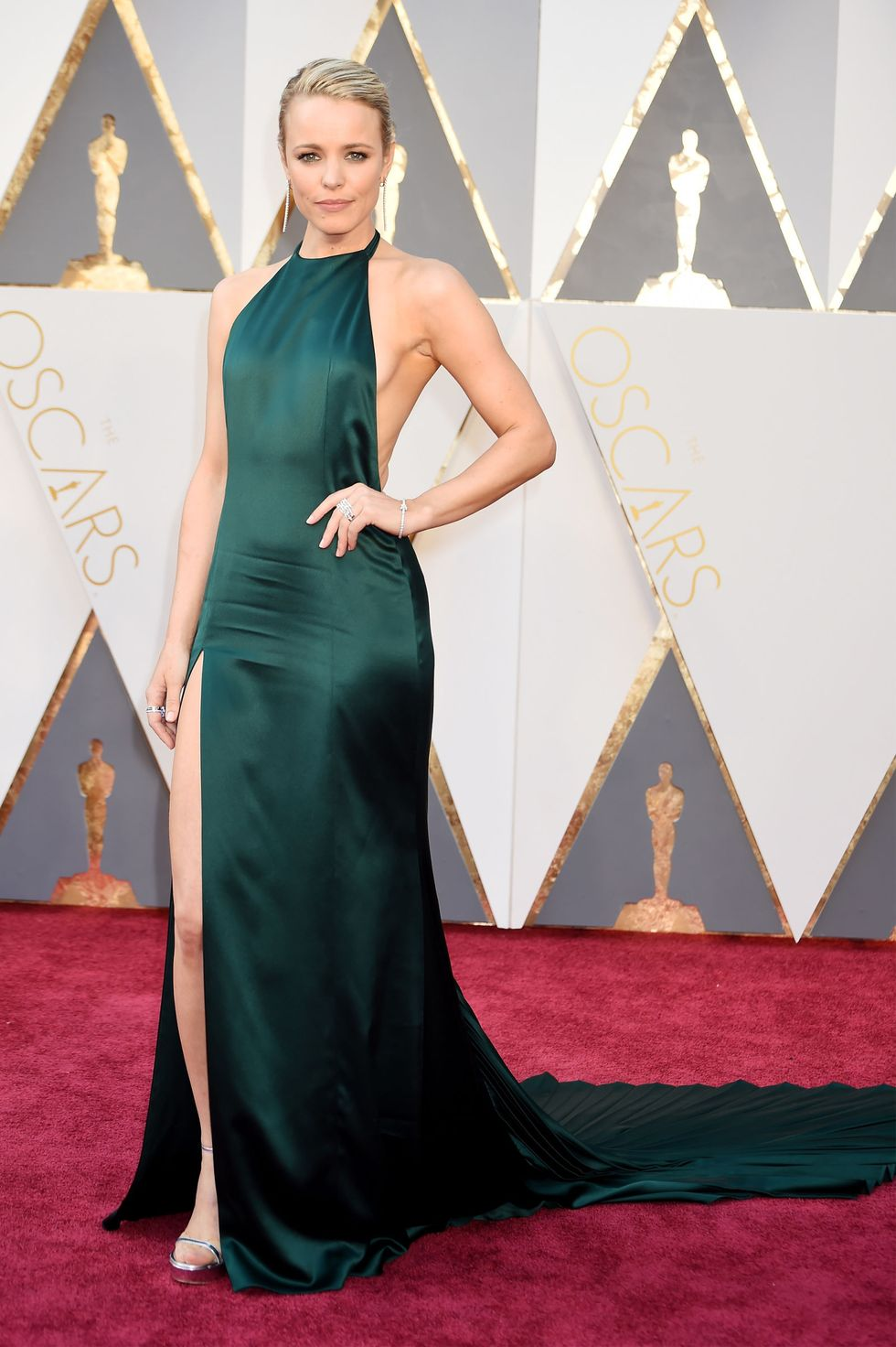Rachel McAdams, 2016 McAdams chose a relatively understated look from August Getty (no over-zealous beading or abundant tulle), but she's subtly pulling off other Oscars staples, too— thigh-high slit, low back, and sweeping train— in a very refreshing emerald hue.