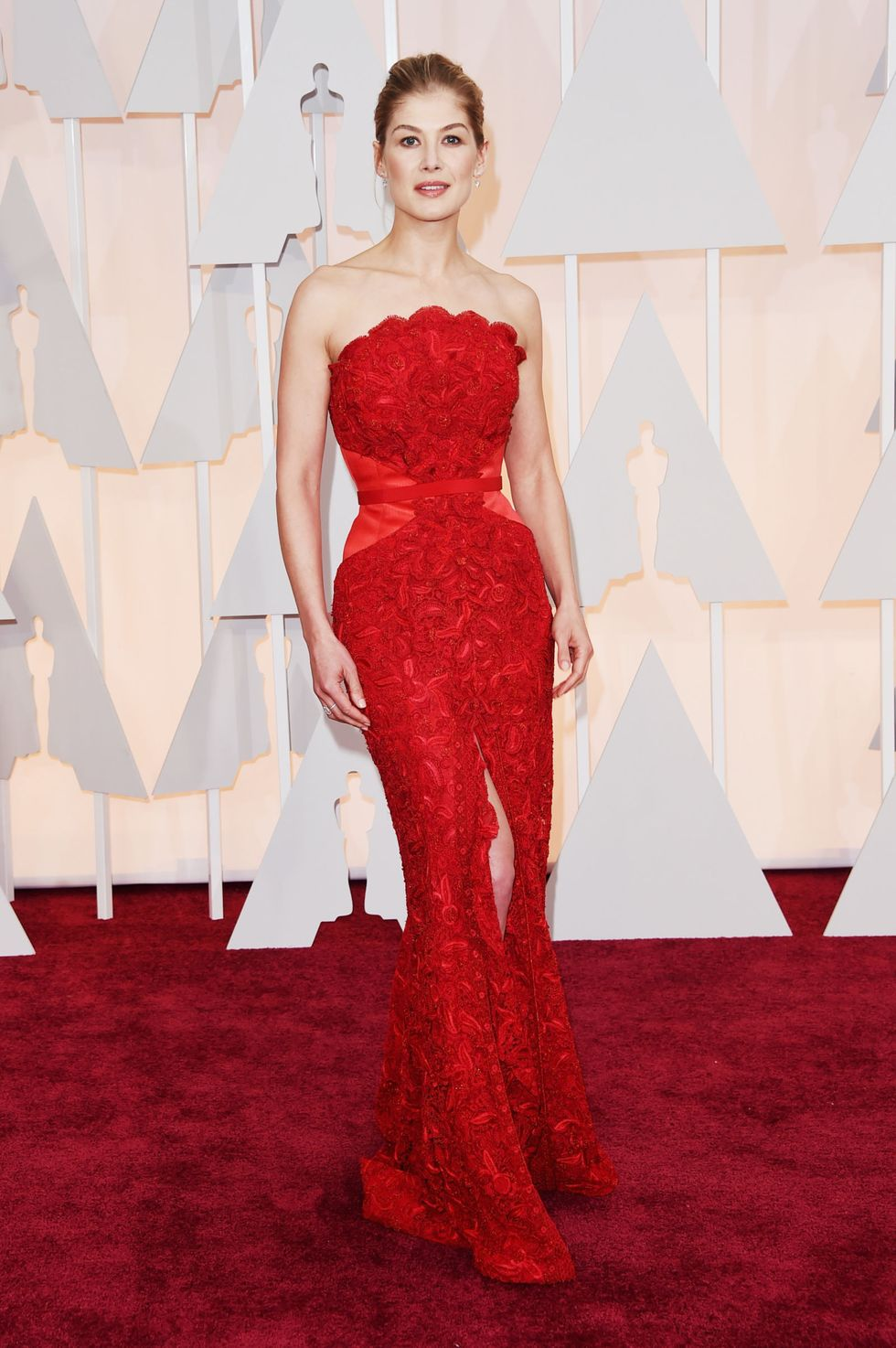 Rosamund Pike, 2015 Pike looks like a statuette herself in scarlet Givenchy Haute Couture, perhaps playing off her unforgettable bloody role in the previous year's Gone Girl .