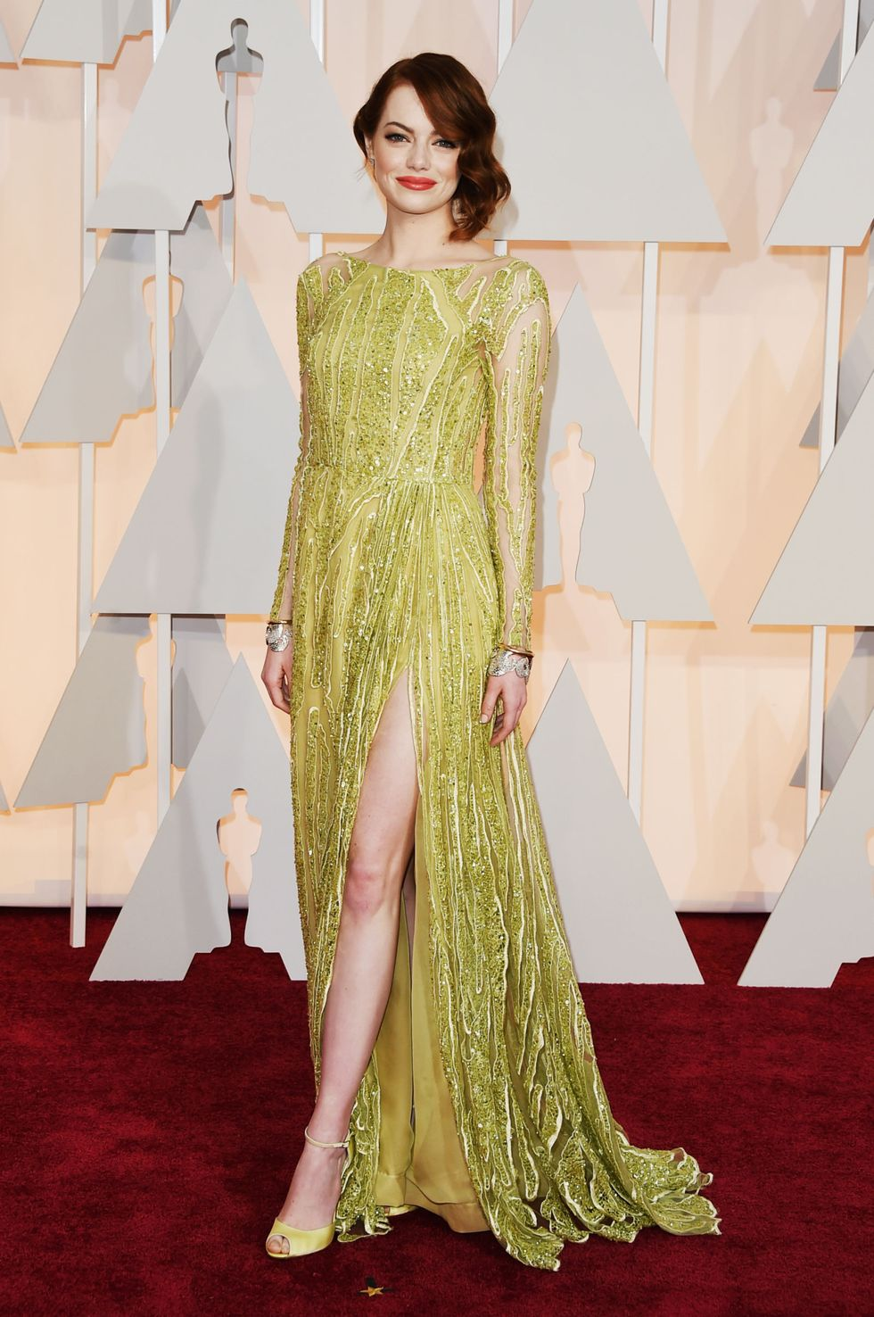 Emma Stone, 2015 One reason why we're thrilled Emma Stone ended up landing the role in La La Land : her auburn hair naturally vibes with the colorful frocks she chooses for red carpet events. Here, she's wearing a risk-taking Elie Saab gown in mustard yellow that 100-percent pays off.