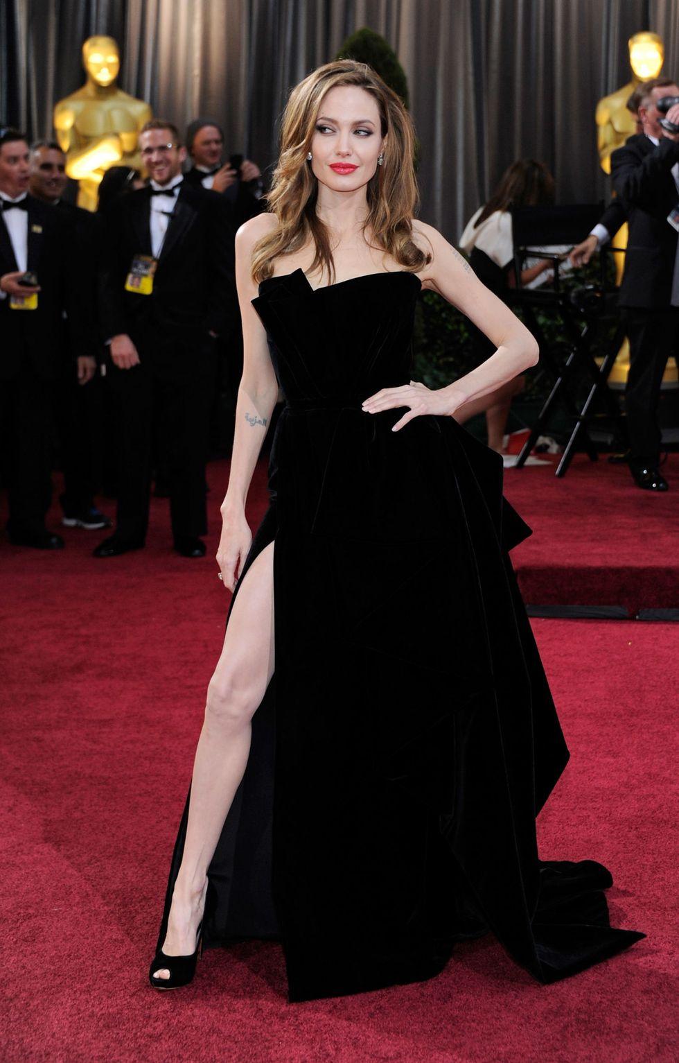 Angelina Jolie, 2012 The Versace look that sparked its own Twitter account (@AngiesRightLeg) was the talk of Tinsel Town in 2012. Many saw it as a return to her cheeky younger red carpet image.