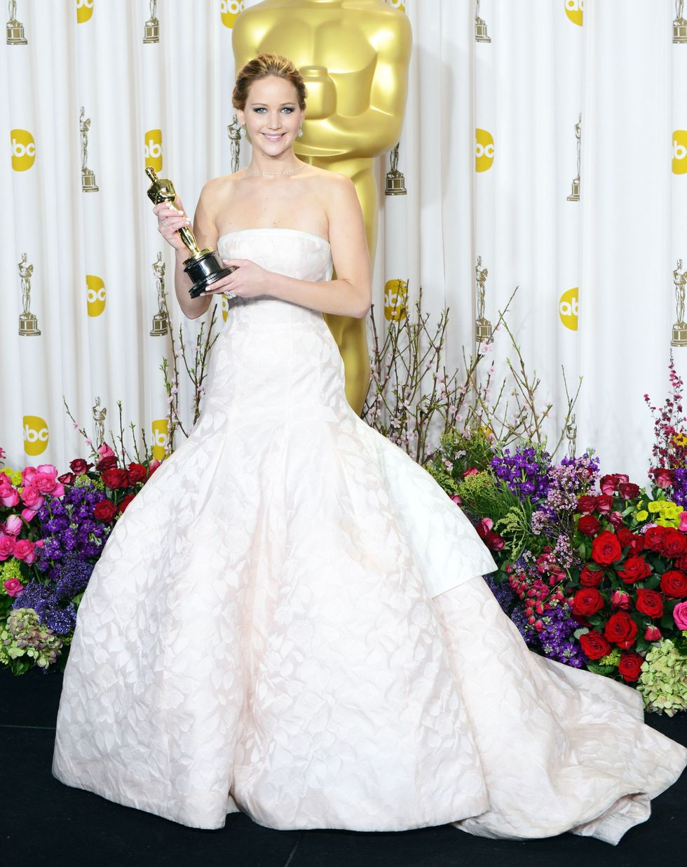 Jennifer Lawrence, 2013 The giant tiered dress that caused the staircase-trip-seen-'round-the-world was a gorgeous haute couture gown by Dior.