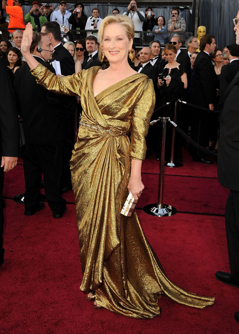 Meryl Streep, 2012 Acting icon and epic speech-giver , Meryl mimicked an Oscar statuette (in her signature red carpet style: floor-length dress and plunging neckline) with this gold lamé Lanvin gown.
