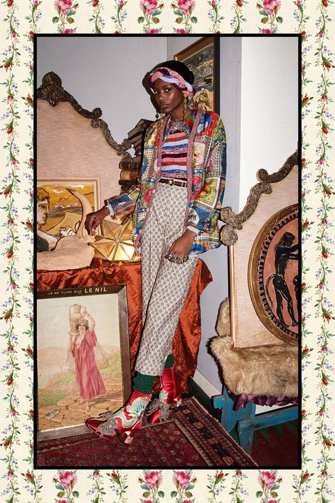 <p>Let's break this Gucci masterpiece&nbsp;down, shall we? Closest to the epidermis, we've got a shirt with a gem-encrusted collar, a stripe-y sweater over that, then a bed jacket. With the cable-knit socks and tall boots, that&nbsp;ought to be enough fabric to get you through the changing of the seasons, when you can remove the jumper and tag in a pair of mules.&nbsp;</p>