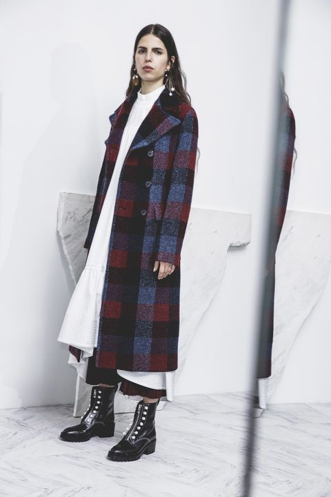 <p>From his&nbsp;extremely wearable, extremely smart pre-fall collection, Phillip Lim brings us perhaps the most doable iteration of the dress-over-pants look yet. Take one long dress, one pair frayed, cropped jeans, and one pair boots a Dickensian orphan might steal from the&nbsp;vicar's niece or something. In the cold, you get extra insulation (could even add tights underneath the denim) and visual interest; in April, remove pants (ahhhh) and coat, keep the shoes.&nbsp;</p>