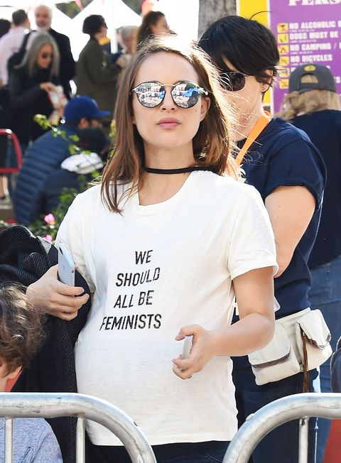 <p>Before they were handed out like hard candies at Couture Week, Natalie Portman wore this Dior T-shirt to the Women's March in L.A.</p>