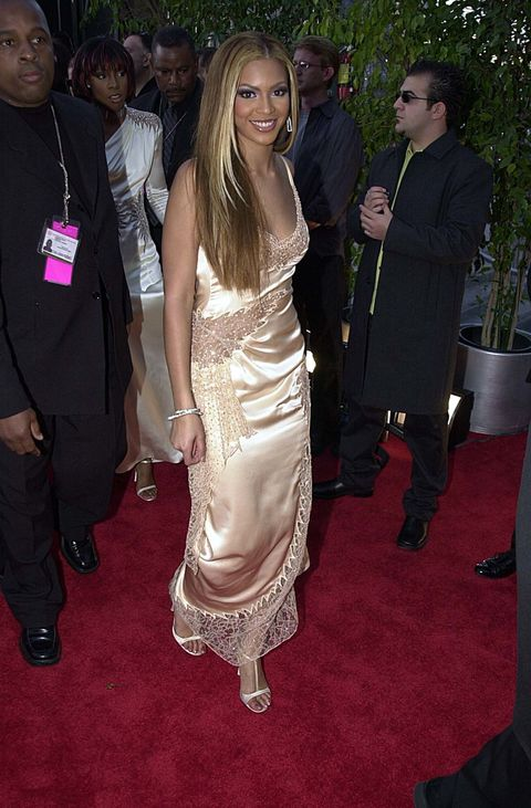 <p>Back in 2001, Beyoncé wore a champagne colored dress designed by her mom Tina Knowles, who was the costume designer for Destiny's Child back in the day.</p>