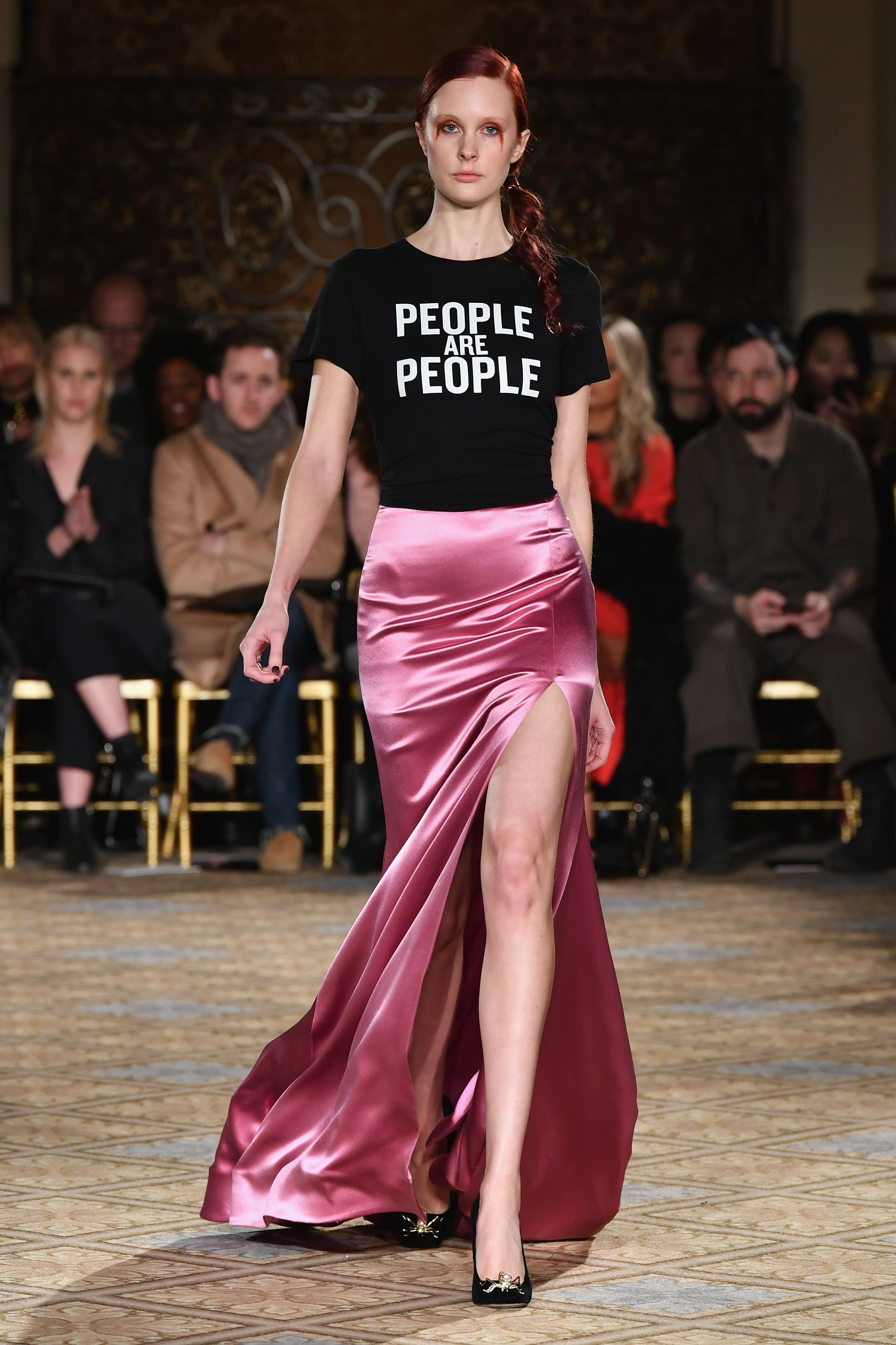 "<p>Siriano echoed the sentiment with a tee-shirt that simply read ""People are People."" Proceeds from the ""see now, buy now"" shirt <a href=""http://store.christiansiriano.com/product/people-are-people-tee-benefits-aclu"" target=""_blank"" data-tracking-id=""recirc-text-link"">benefit the ACLU</a>. </p>"