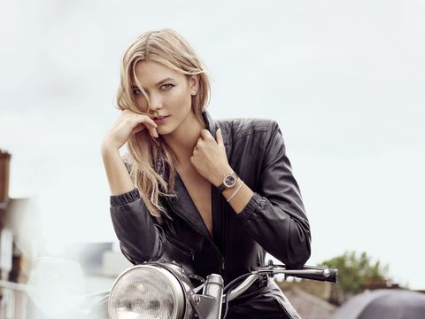 Motorcycle, Fashion accessory, Jewellery, Beauty, Glass, Model, Motorcycle accessories, Eyelash, Blond, Long hair,