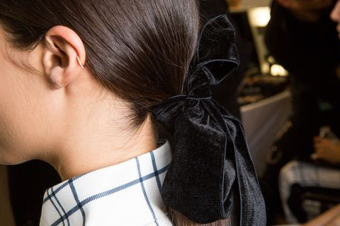 <p>Bad hair day? Throw an accessory on it. At Tory Burch, Redken creative director Guido Palau adorned each undone-feeling ponytail with an asymmetrical velvet ribbon. Similar throw-a-statement-piece-on-it hair could be seen at Marchesa, where gorgeous bloom hair accessories were placed on top of the wispy, sideswept updos.</p>