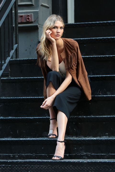Clothing, Stairs, Human leg, Shoulder, Shoe, Dress, Joint, Standing, Style, Street fashion,